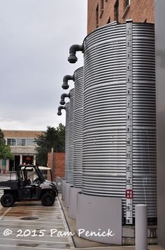 Cisterns store rainwater from the roof. Smart, water-saving landscaping at UT's Belo Center | Digging
