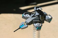 https://flic.kr/p/oaFaw7 | Raptor H4/C5 Offensive Drone (Close Up) | The Raptor H4/C5 Offensive Drone is a military drone used in assault operations. Lightweight and heavily armed, this weapon is highly deadly in any situation.  I built this a while ago and never got to taking photos of it. It has several functions including a moving cannon and adjustable engines.The front cannon's tip is a Brickarms M2HB tip. I am taking this one to Brickfair. Hope to see you there!