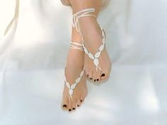 "Something like these, but with beading...  ""Crochet  barefoot sandals cream foot decoration nude by Lasunka, €10.00"""
