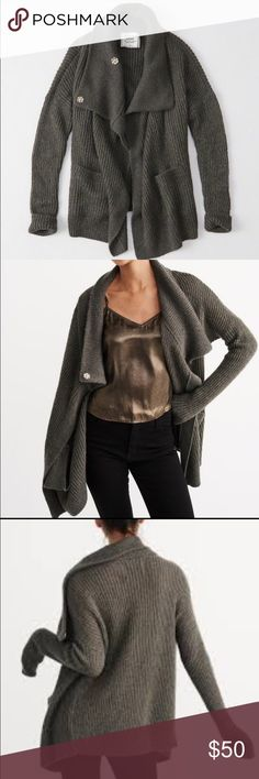 Abercrombie Shine Cardigan Dark charcoal grey with metallic threads running through. Worn once so it's practically new. This runs a bit large. Abercrombie & Fitch Sweaters Cardigans