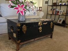 DIY Coffee Table from Antique Steamer Trunk; I like the clean, simpleness of the table but will probably go with something for fun & creative! But this could always be an option?
