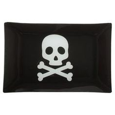 """Whether you're serving up spooky Halloween treats or celebrating a pirate-themed birthday, this skull and crossbones tray adds a pop of style to your buffet or kitchen island.  Product: TrayConstruction Material: GlassColor: Black and whiteDimensions: 7.5"""" H x 11.75"""" D"""