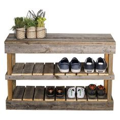 The Del Hutson Reclaimed Wood Shoe Rack helps you keep shoes neatly organized with two lower shelves and sturdy reclaimed wood construction. This charming shoe rack also serves as a handy bench for a