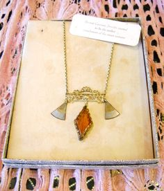 A 1920s Art Deco necklace with fan motif in its original box