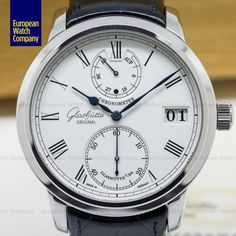 Glashutte Original 58-01-01-04-04 Senator Chronometer, 5801010404, 18K white gold with white gold deployment buckle, manual wind Glashutte caliber 58-01, COSC, 45 hour power reserve indicator, big date at 3 O'clock, hacking device, indexing minutes, day night indicator, water resistance 50 meters, three quarter plate, swan neck fine adjustment, size 42mm, thickness 12.3mm, Like New with Original Box and Papers dated 1 / 2010.