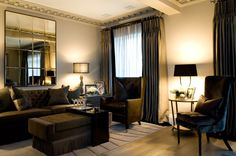 Belgravia Apartment in dark hues of brown and grey and a mirror feature | INTARYA luxury interior design |