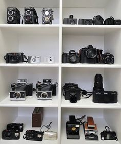 One day this will be me.  I've already got 4 SLRs, a Twin Lens Reflex, a brownie, and a D-SLR.  Next I'd like to expand my lens collection for my D-SLR and one day buy a Hasselblad instead of a new car.