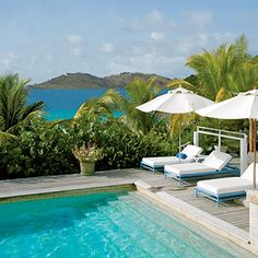 Hotel St. Barth Isle de France  Lounge by peaceful Flammands Bay or by the pool, large by St. Barts standards. Rooms have a soft-white, French country flair.