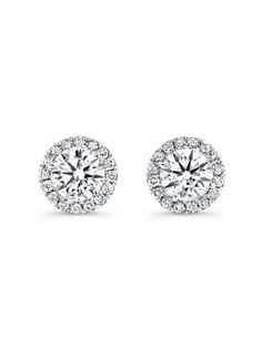 Total stunners to match the bride's elegant look. 18K  white gold diamond halo stud earrings from Forevermark. #jewellery