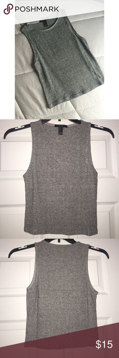 ✨NWOT✨ Forever21 Grey Ribbed Knit Top This top is NWOT. Never worn because I bought the wrong size. Top is super cute! Ribbed, knit material. Shirt is slightly cropped. Color: Grey. Size is US small. Forever 21 Tops Crop Tops