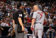 Matt Holliday #7 of the St. Louis Cardinals argues with homeplate umpire Mike DiMuro #16 before getting ejected in the fourth inning against the Atlanta Braves at Turner Field on September 9, 2010 in Atlanta, Georgia.