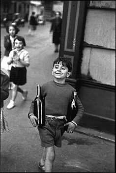 Henri Cartier Bresson was one of the best photographers of his era - no digital camera and he captured the joy of a young boys face and the street scene around him.