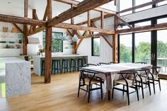 A dilapidated barn was updated for modern living by architectural studio La Firme, located on a country property in Quebec, Canada. Log Home Plans, Barn Plans, Metal Building Homes, Building A House, Wood Room Divider, Modern Barn House, Garage Apartment Plans, Light Hardwood Floors, Timber Beams