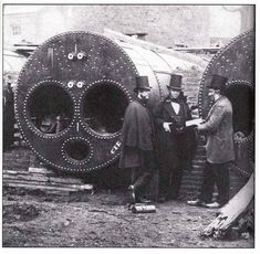 Engineers in discussion against a backdrop of three Lancashire boilers during their erection for the International Exhibition London of 1862