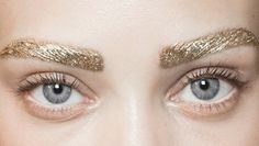 Gold eyebrows high fashion runway makeup