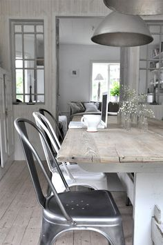 Tolix chairs, distressed wood table, white, grey