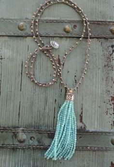 A crocheted chain of sparkly faceted semi precious stones holds an opalescent glass tassel. Artisan sterling silver button and loop closure. Dress it up or down! Measures 34 with a 4 tassel drop. *Shown layered with other necklaces also available in my shop separately. As with all of my jewelry, I ONLY use TOP quality materials in my work. The result is well worth it and it shows! ORIGINAL LIST DATE: Dec. 10, 2014* Often imitated, never duplicated!-- You see it here first :)