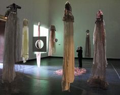 """Diana Brennan ~ """"Les Robes Lune"""" 2008 Musée Galliera Installation """"From discarded clothes, felted wool from old sweaters … secured long skirts to the fragile and gossamer beauty, knitted enamelled copper, nickel, polyester, lurex…  myriads of small transparent beads… like drops of dew or rain iridescent textile surface."""" *Moon Dresses* Photo S Franceschini, via Bloc-Mode Archive"""
