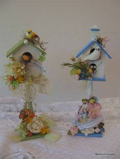 decorated bird houses with flowers and lace.