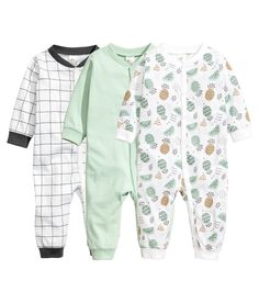 Check this out! CONSCIOUS. Long-sleeved, one-piece pajamas in soft organic cotton jersey with snap fasteners at front and along one leg. Ribbing at cuffs and hems. - Visit hm.com to see more.