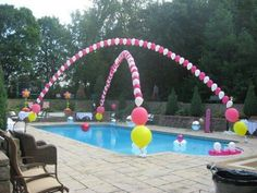 Helium filled balloons attached to fishing line and strung over the pool