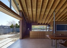 Double-height dining room added to a family house in Japan.