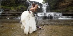Rock the dress - Cummins Falls, Cookeville, TN. Waterfall trash the dress session, Bride & groom, dramatic couple portrait by Ashley Lodge Photography, Destination Wedding Photographer #ALBrides #AshLodgeAart