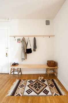 i really want a super simple bench and a row of hooks for our entry hall, and we neeeeeed a runner desperately. definitely needs to be nice and light like this space, because the hall is dark otherwise.