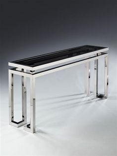 A 20TH CENTURY CHROME AND GLASS CONSOLE TABLE