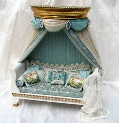 Sleigh daybed with circular coronet, silk brocade, gold leaf, 12 hand-stitched cushions ~ http://dollshouseinterior.co.uk/day_beds.htm