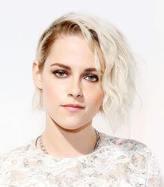 Kristen Stewart's platinum hair with deep side part and textured waves.