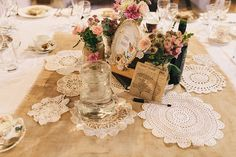 Wedding doilies table decor, from 'A 1920s and 1930s Antique and Old Fashioned Vintage Inspired Barn Wedding'.  Photography http://www.brighton-photo.com/