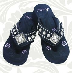 Black wedge flip flop with diamond concho.