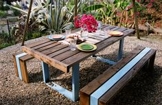 "Never been a big fan of picnic tables - but like this.  Price is prohibitive, but could easily ""do your own"" version.  Would be cool with the trough for drinks down the middle in other pics."