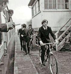 Ringo Starr and George Harrison ride bikes. John Lennon and Paul run.