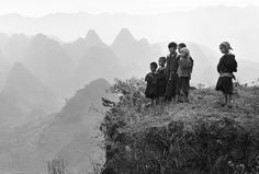 Where a road has been built in a mountainous region young children have run uphill to watch automobiles, 1982 - by An Ge (1947), Chinese