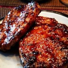 """World's Best Honey Garlic Pork Chops """"A quick and simple grilled pork chop that everyone will love featuring a simple and easy glaze."""" World's Best Honey Garlic Pork Chops – World's Best Honey Garlic Pork Chops Pork Chops And Rice, Honey Garlic Pork Chops, Honey Glazed Pork Chops, Smoked Pork Chops, Traeger Pork Chops, Sweet And Sour Pork Chops, Brown Sugar Pork Chops, Mexican Pork Chops, Asian Pork Chops"""