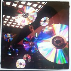 Hang CDs from the ceiling for party decor. Easy peasy + looks RADICAAAAL, rainbow prisms all ova. Me thinks it's time to plan a 90s theme party. Parachute pants, here I come...