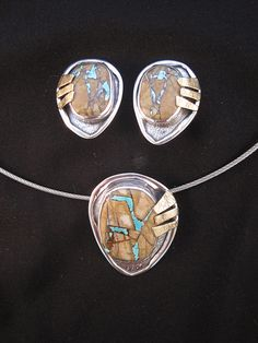 e-bu jewelry  ||  Royston ribbon turquoise set with sterling silver and bronze. Pendant $434. Clip earrings $510.