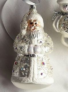 Adorned with sparkling Swarovski crystals, the hand-blown Glitz and Glamour Swarovski Crystal Santa Ornament is sure to dazzle your guests and add a shimmering touch to your Christmas tree.
