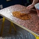 Cover a desk in pennies