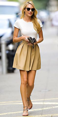 Simple and classic outfit. White tee and pleated tan skirt...and those glasses