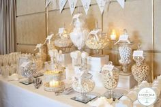Ivory and white candy table at a wedding event