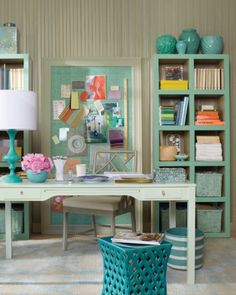 Office Decor: grayish blue greens are layered to create a calming effect in a home office. The warm gray wall color was also used on the sides and interiors of the open-back bookcases, giving them the feel of built-ins. From Martha Stewart: Home & Garden.