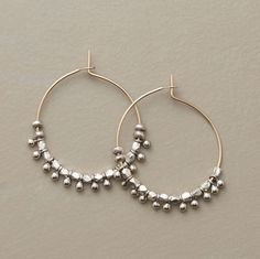 """TEMPTRESS OF THE NILE EARRINGS--Simply enticing, sterling silver dangles hold sway on elegant 18kt goldfilled hoops. Handmade in the USA. Exclusive. 1"""" Dia."""