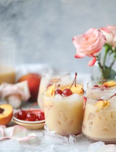 Iced peach colada mocktails that mix peach juice with pineapple juice and coconut milk over crushed iced, all topped with maraschino cherries! Summer Drinks, Fun Drinks, Juice Drinks, Beverages, Food Porn, Peach Juice, Alcohol Drink Recipes, Non Alcoholic Drinks, Cocktail Recipes