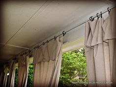 Handmade curtain panels for outdoors made out of painters drop cloths from Home Depot and rods from electrical conduit! No sewing! I may stamp a design on mine.Awesome!!