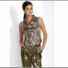 Snakeskin print Vest Super cute Bcbgmaxazria snakeskin print Vest excellent condition no damage worn once I can no longer zip up can be dressed up or worn with jeans BCBGMaxAzria Jackets & Coats Vests