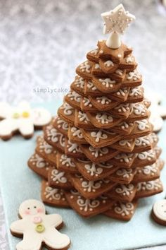 Send the cookies and stand and let him assemble it when it arrives. build your own Christmas tree!