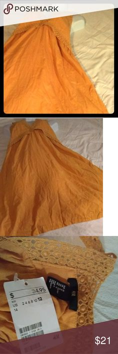 Mustard color dress size 12 Mustard color dress size 12 t-strap with design on the chest in the front of the dress very nice hm is the designer new with tags. H&M Dresses Midi